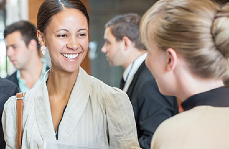 Woman laughing at networking event